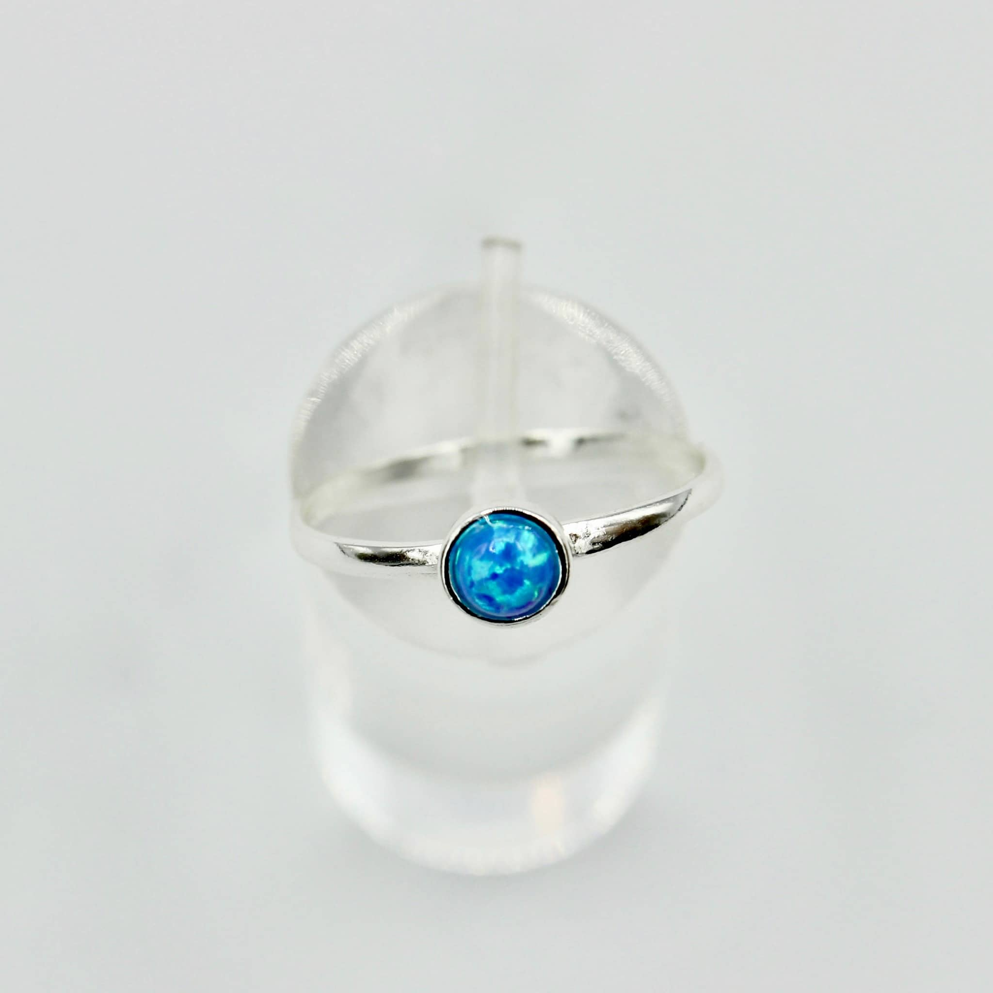 Round aqua stoned sterling silver ring