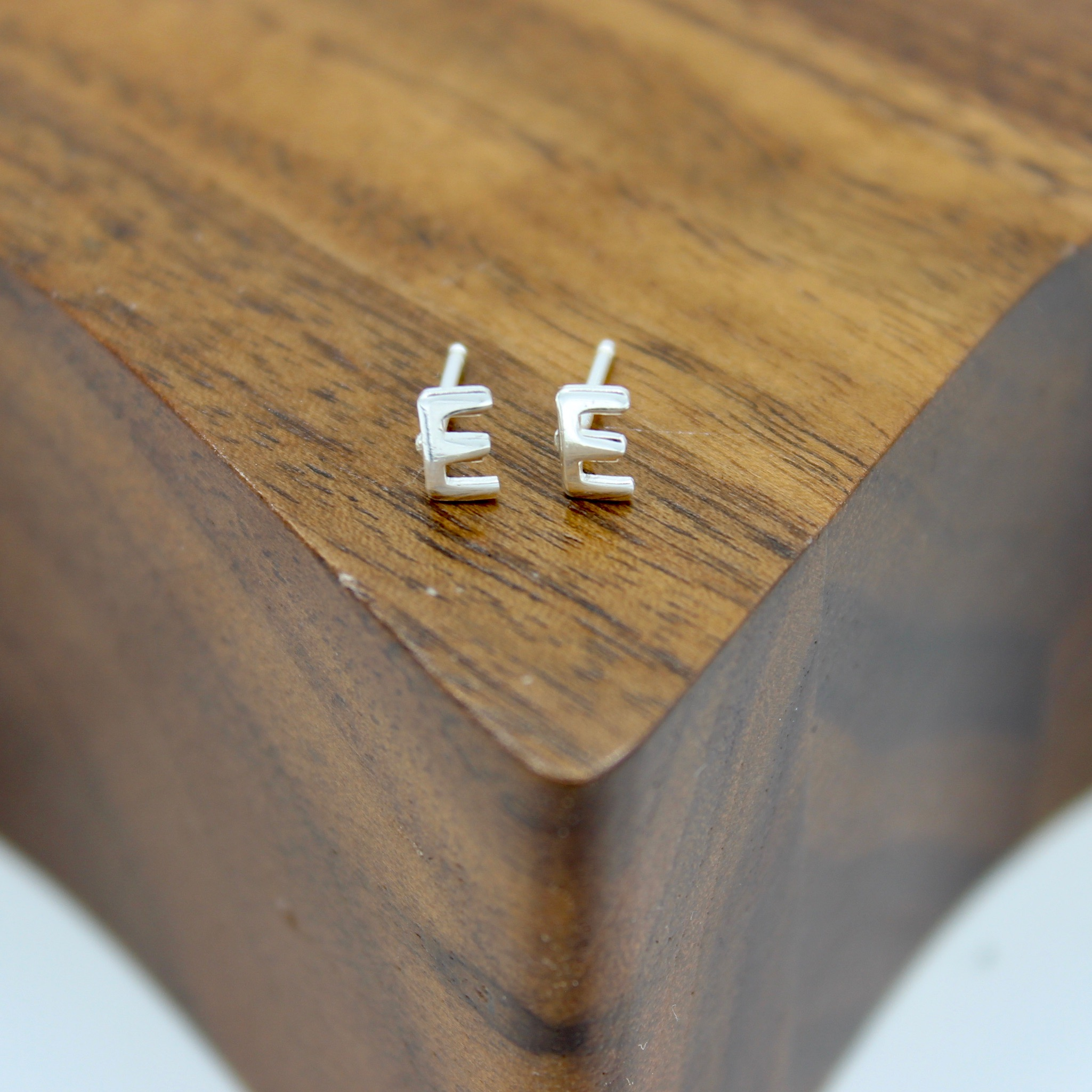 Capital E Stud earrings